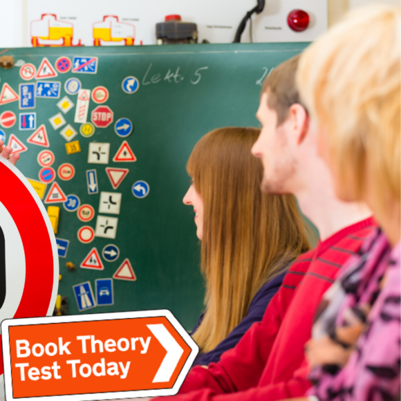 Learner drivers doing theory test revision.