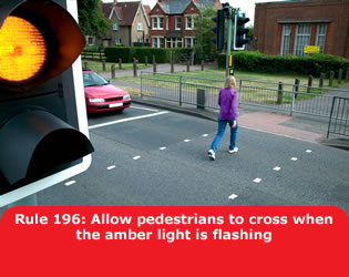 Allow pedestrians to cross when the amber light is flashing
